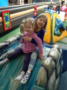 Blythe and Simone enjoying an indoor playground in their new hometown of Calgary. Photo credits: Kerry & Arne Dankers.