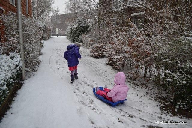 sophia-taking-her-little-sister-for-a-sled-ride