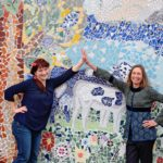 Mosaic artist Nan Deardorff-McClain with Ildikó Wooning organizer giving each other high five after all the work that has been done