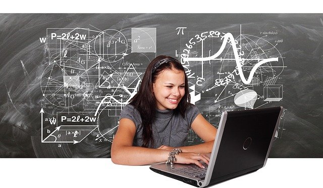 student looking at laptop